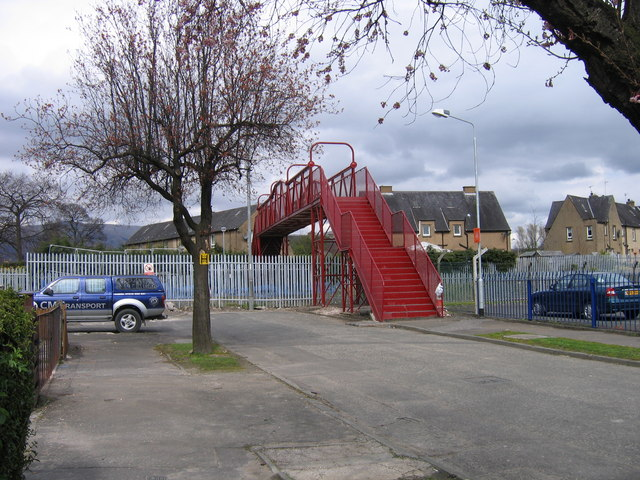 Red bridge and  blue cars at Alloa