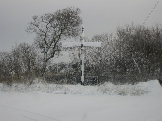 Snow covered signpost