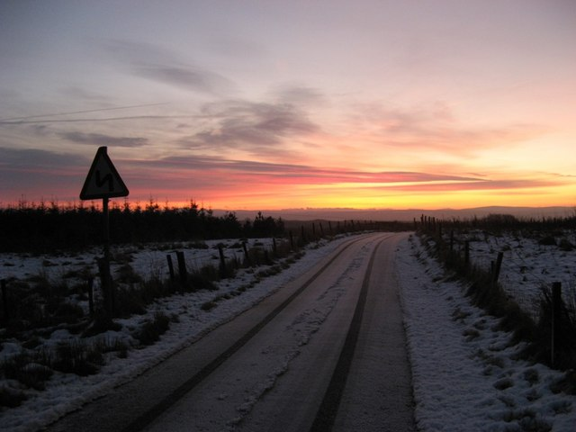 Dawn breaks on the road over Ardrochrig hill