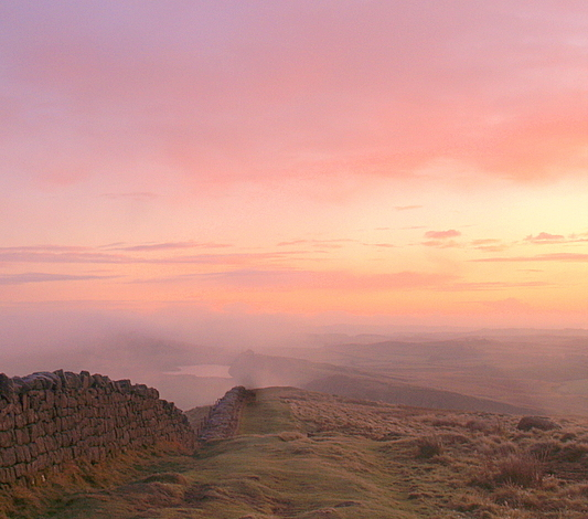 Crag Lough and Steel Rigg in a misty sunrise