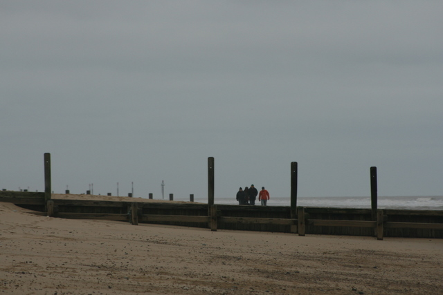 Christmas Day walkers on the beach