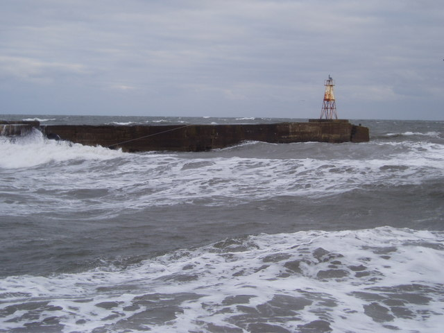 Amble north pier light in heavy seas