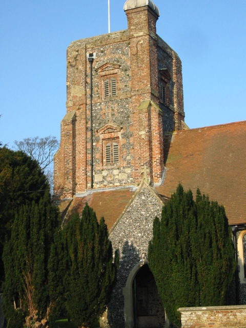 The brick and flint tower of Ringwould's St Nicholas church
