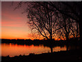 TQ4780 : Sunset over Southmere lake by Linda Craven