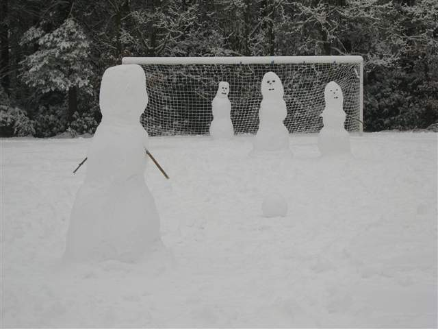 Snowmen Playing Football