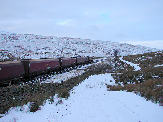 An empty coal train heads north on the Settle & Carlisle Railway
