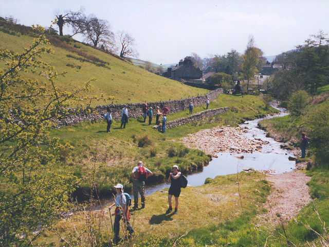 Walkers alongside Hebden Beck
