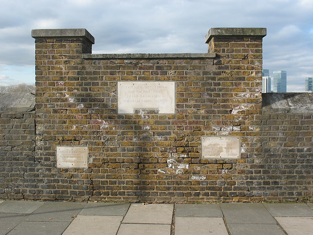 Thames flood level markers at Trinity Hospital, Greenwich