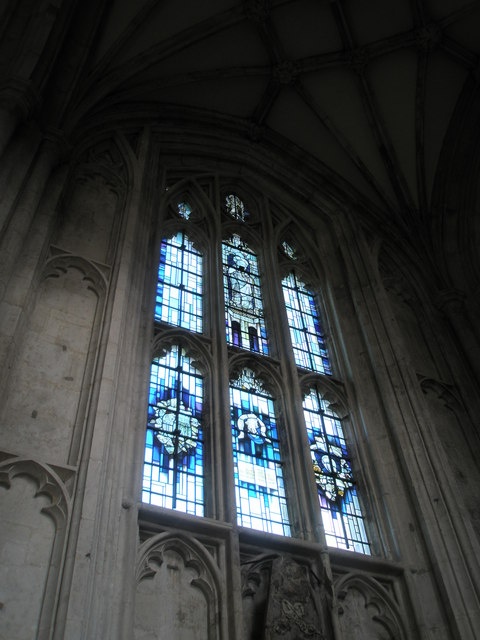 Unusual blue and purple stained glass window on the north wall at Winchester Cathedral