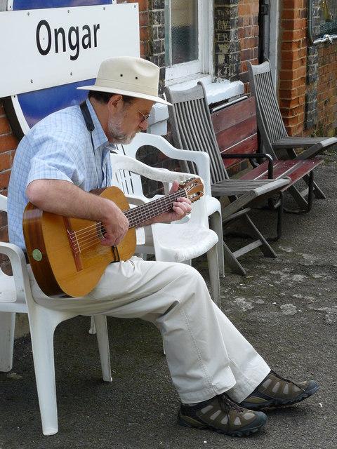 Musician Entertaining at Ongar Station