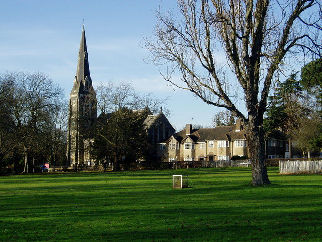 St Mary's church from Churchfields Recreation Ground with a glebe stone in foreground
