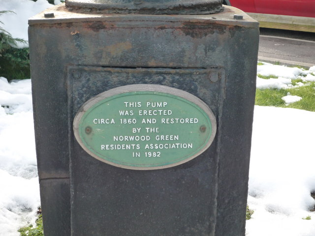 Plaque on water pump next to the Wolf public house