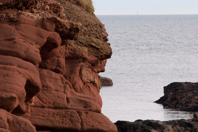 West end of Cliffs at Arbroath with a view of Bell Rock Lighthouse