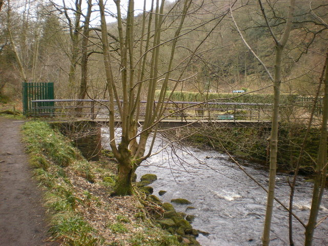 Footbridge across Hebden Water to the bowling green below Lee Mill Bridge