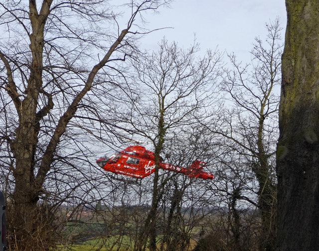 Air ambulance landing Trent Park, London N14