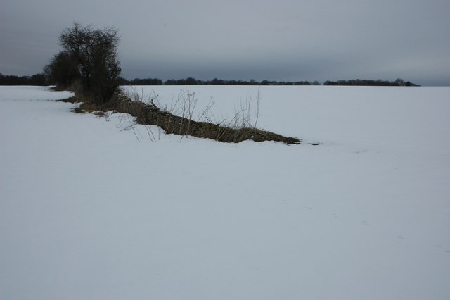 Snow covered land above Kineton