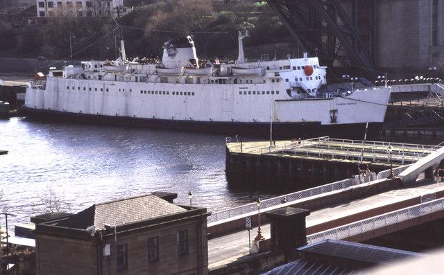 Tuxedo Royale moored under the Tyne Bridge
