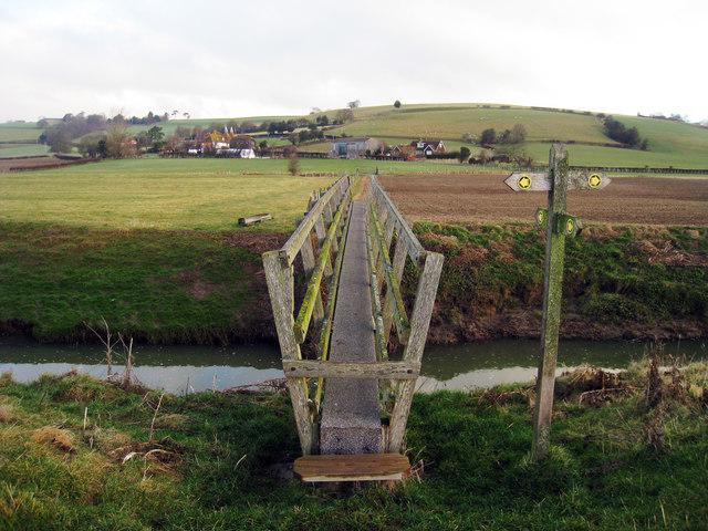 Footbridge over River Brede near Float Farm