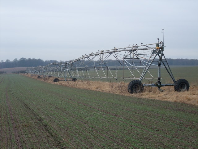 Linear irrigator in field next to Budby Drive