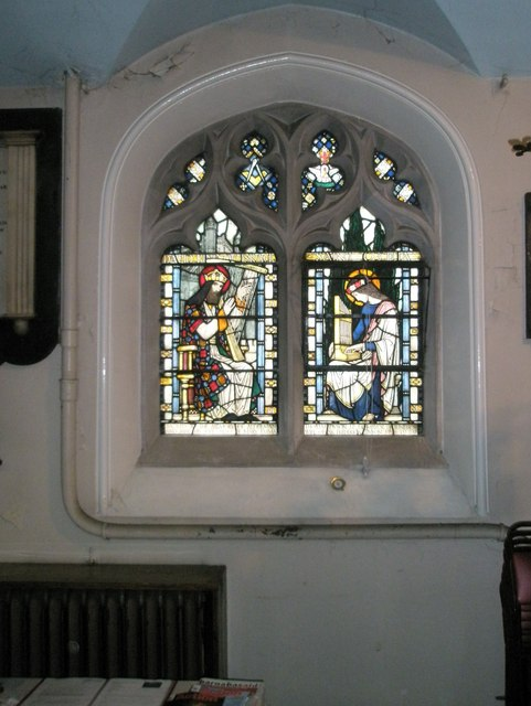 Intricate stained glass window on the south wall of St John the Baptist, Windsor