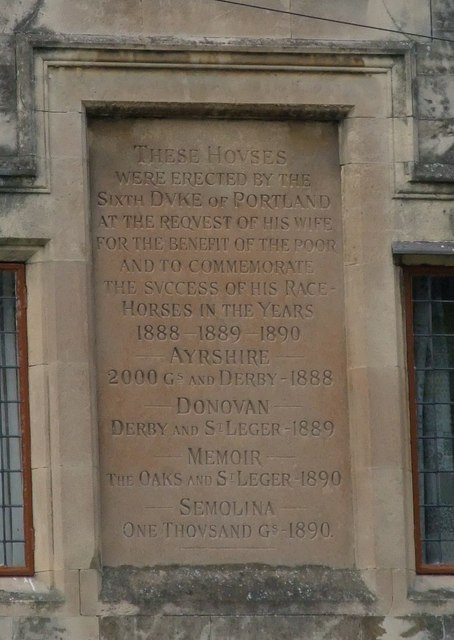 Memorial plaque on 'The Winnings' almshouses
