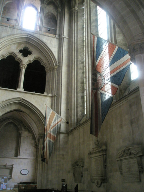 Flags on the west wall at Romsey Abbey