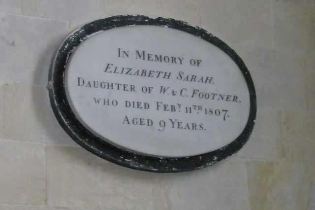 Simple memorial on the north wall of Romsey Abbey