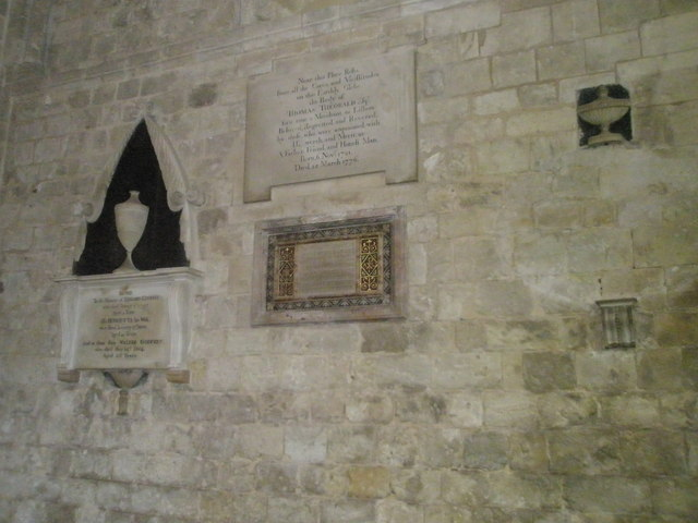 A variety of memorials on the south wall at Romsey Abbey