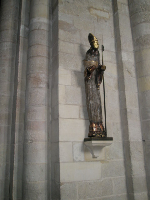 Narrow statue on the wall of the south transept at Romsey Abbey