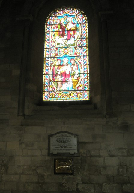 Memorials below a stained glass window at Romsey Abbey