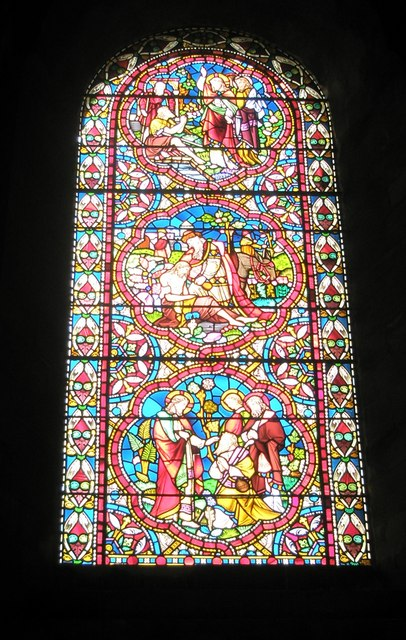 Intricate stained glass window on the south wall of Romsey Abbey