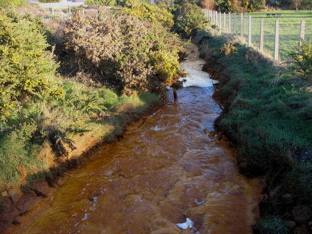 Polluted stream flowing through the Lon Goch Recreation Ground
