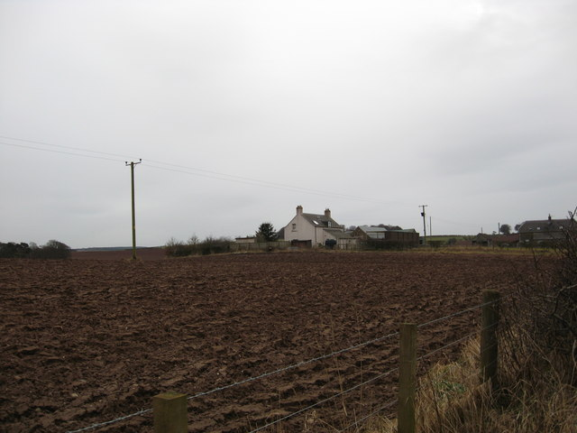 Ploughed field and buildings at Brownrigg Farm.