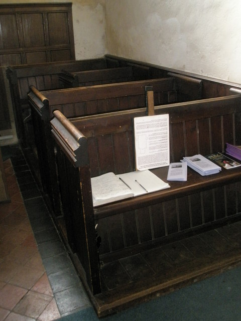 Ancient pews within Wisley Parish Church