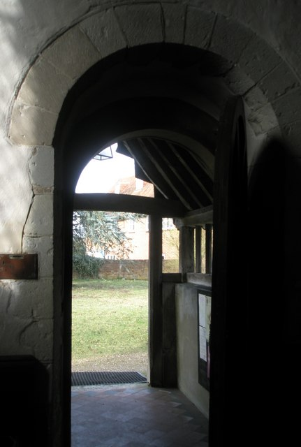 Looking out of the door and into the churchyard at Wisley