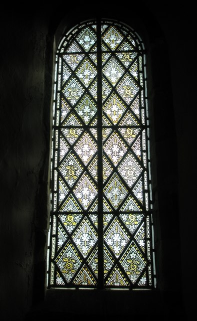 Charming stained glass window on the north wall at Wisley Parish Church