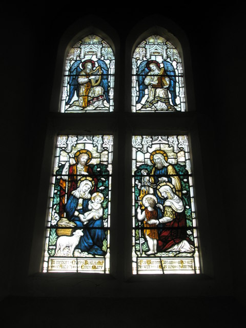 Four superb stained glass windows above the  altar at Wisley Parish Church