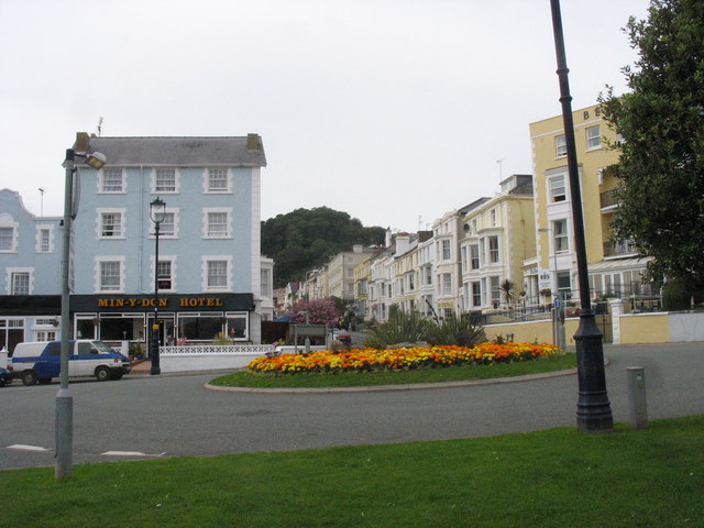 Flowery traffic island and the junction of North Parade and Church Walks