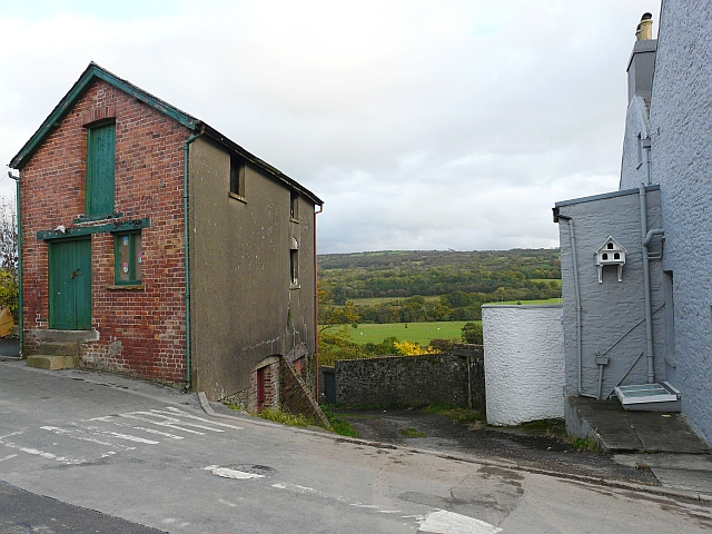 View between buildings towards Towy Valley