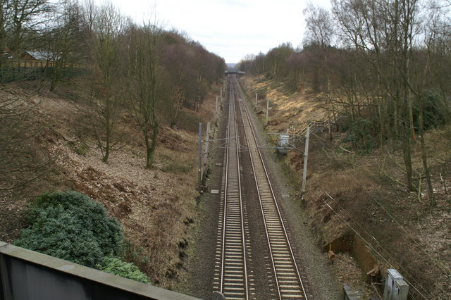 Looking due South down the West Coast Main Line on Wigan Lane (A49)