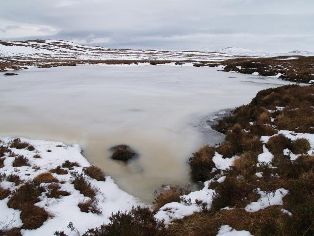 Frozen lochan near Fain