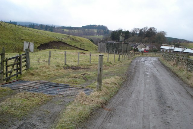 Bent Cattle Grid alongside Farm Road