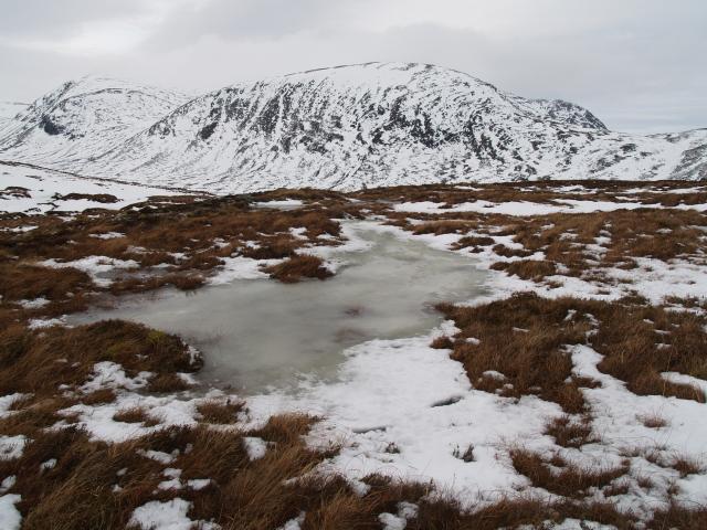 Frozen bogpool, NW ridge, Meall Feith Dhiongaig