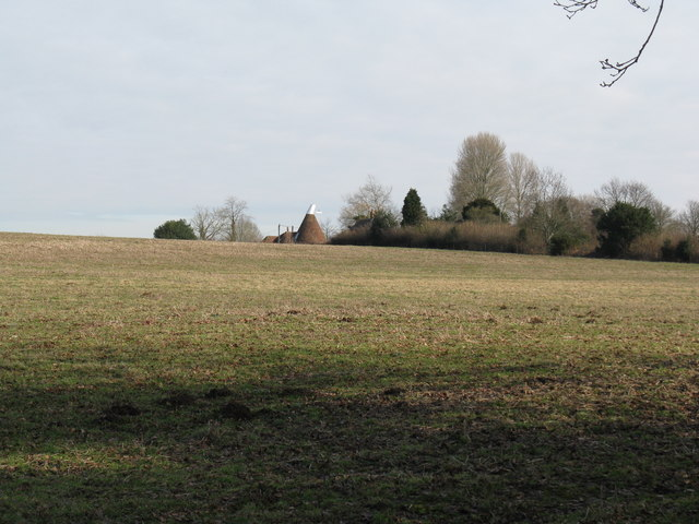 Field view across to converted Oast House