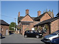 SJ5658 : Bunbury - rear view of Dysart Arms with St Boniface's Church behind by Ian Cunliffe