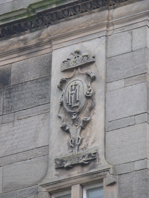 Plaque on the Henderson Pharmacy building