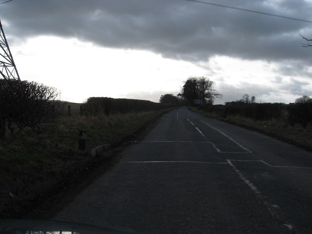 Minor road heading away from the junction with the A68