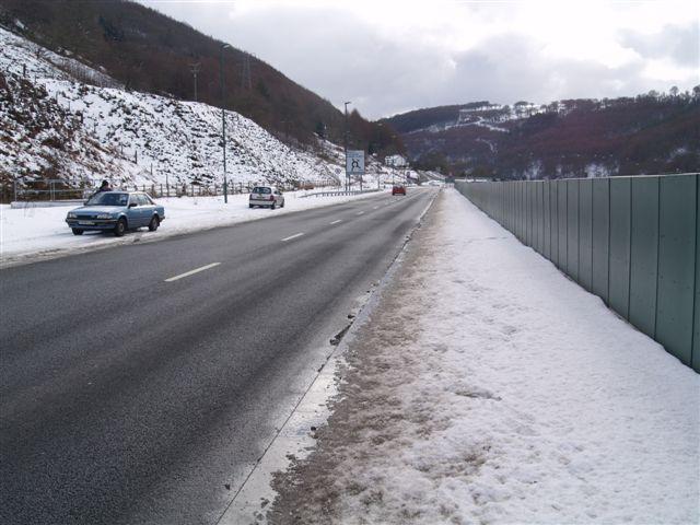Snowy road scene in Cwm
