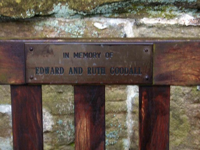 Memorial plaque on seat in St. Saviour's churchyard