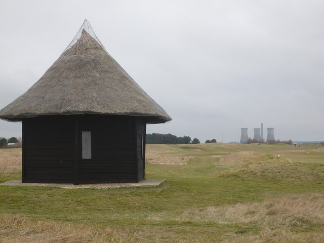 A shelter on Prince's Golf Course with Richborough Power Station in the distance